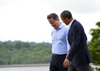 British Prime Minister David Cameron (L) and US President Barack Obama (R) walk and talk during the official welcome as world leaders arrrive for the start of the G8 Summit in at the Lough Erne resort near Enniskillen in Northern Ireland on June 17, 2013. The conflict in Syria was set to dominate the G8 summit starting in Northern Ireland on Monday, with Western leaders upping pressure on Russia to back away from its support for President Bashar al-Assad. AFP PHOTO / JEWEL SAMAD (Photo credit should read JEWEL SAMAD/AFP/Getty Images)